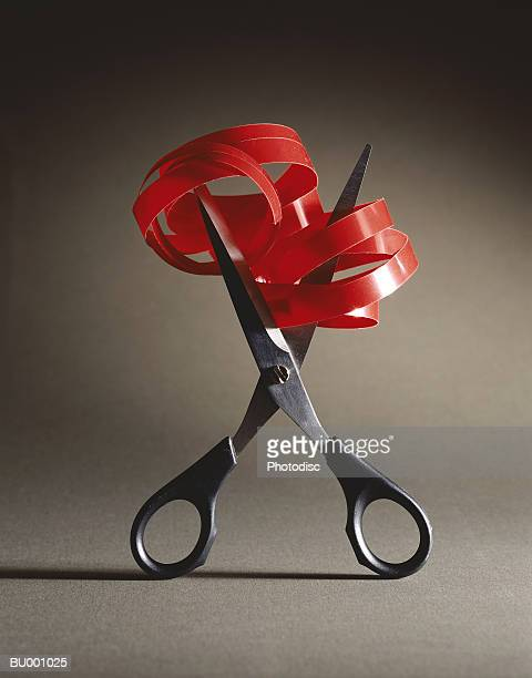 scissors cutting red tape - bureaucracy stock pictures, royalty-free photos & images