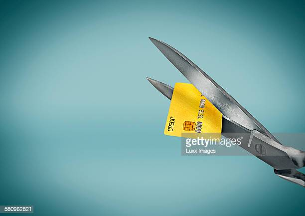 Scissors cutting up credit card