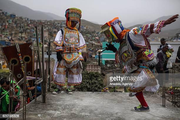 Scissors dancers perform at the Nueva Esperanza cemetery Villa Maria del Triunfo district during the Day of the Dead celebrations in Lima Peru 01...