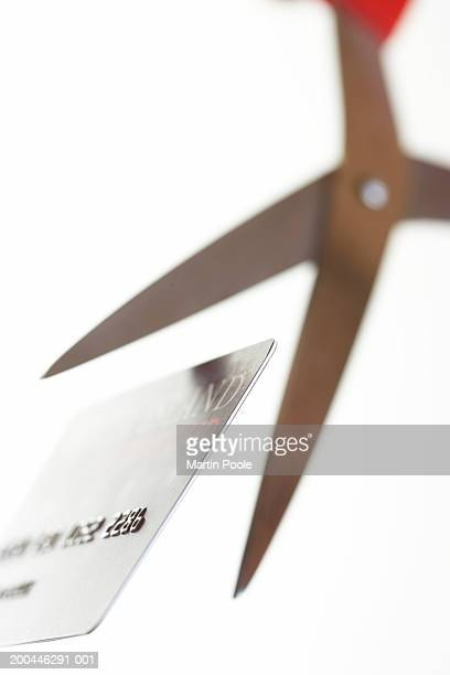 Scissors positioned to cut credit card, close-up