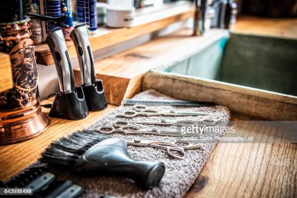scissors, razor and brush on barber shop counter - barber shop stock photos and pictures