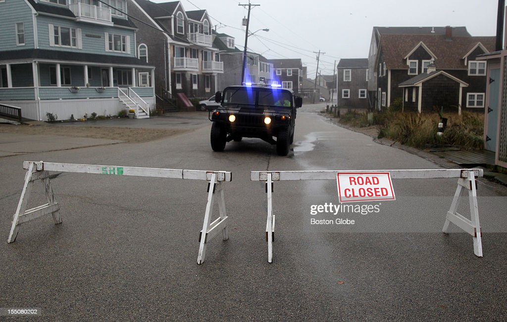 Scituate Police Department close Light House Road as a precaution before high tide as Hurricane Sandy approaches Massachusetts.