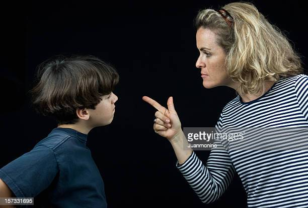 scolding the boy - mother scolding stock pictures, royalty-free photos & images