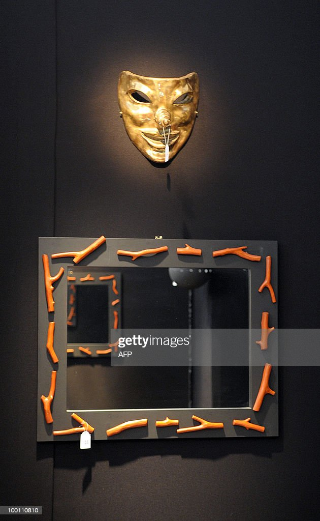 A sconce and mirrors designed by Elizabeth Garouste and Mattia Bonetti for French fashion house Christian Lacroix are among about 100 lots exhibited at the auction house Sotheby's France in Paris on May 21, 2010 before a sale on May 26, 2010 organised at the initiative of Christian Lacroix Company. In 1987 Christian Lacroix hired furniture designers Garouste and Bonetti to create the complete bespoke interior of his fashion house located on the Parisian Faubourg Saint Honore. Apart from the salons, the team also designed the packaging, the writing paper, the logo.