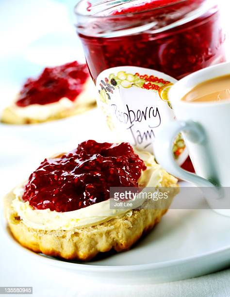 scone with cream & raspberry jam - afternoon tea stock pictures, royalty-free photos & images