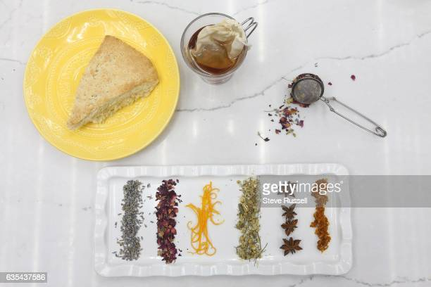 TORONTO ON FEBRUARY 7 Scone with ingredients for blending your own tea include lavender rose leaves orange camomile star anise and turmeric