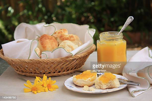 scones with lemon butter - jill harrison stock pictures, royalty-free photos & images