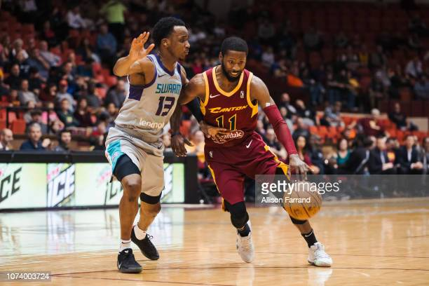 Scoochie Smith of the Canton Charge drives against Joe Chealey of the Greensboro Swarm on December 15 2018 at the Canton Memorial Civic Center in...