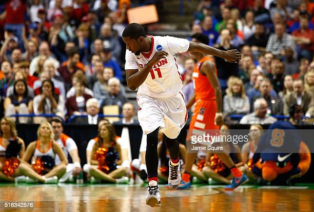 Scoochie Smith of the Dayton Flyers celebrates after a three point basket in the first half against the Syracuse Orange during the first round of the...