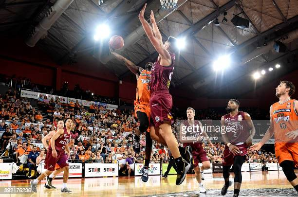 Scoochie Smith of the Taipans drives to the basket during the round 10 NBL match between the Cairns Taipans and the Brisbane Bullets at Cairns...