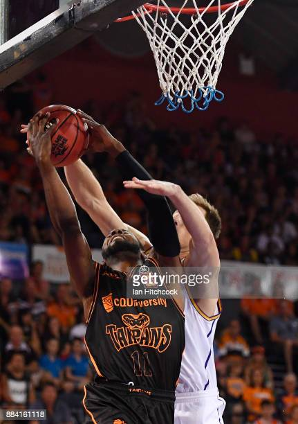 Scoochie Smith of the Taipans is fouled by Brad Newley of the Kings during the round eight NBL match between the Cairns Taipans and the Sydney Kings...