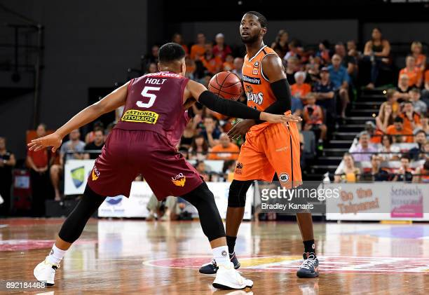 Scoochie Smith of the Taipans looks to pass during the round 10 NBL match between the Cairns Taipans and the Brisbane Bullets at Cairns Convention...