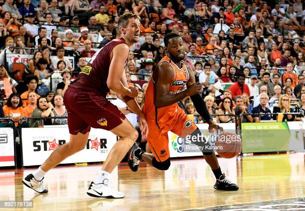 Scoochie Smith of the Taipans takes on the defence during the round 10 NBL match between the Cairns Taipans and the Brisbane Bullets at Cairns...