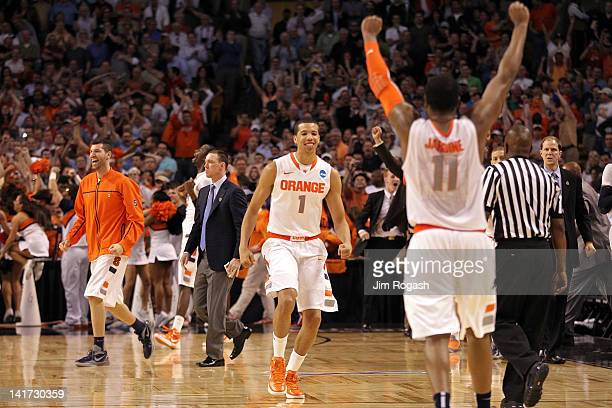 Scoop Jardine and Michael CarterWilliams of the Syracuse Orange celebrate after defeating the Wisconsin Badgers during their 2012 NCAA Men's...