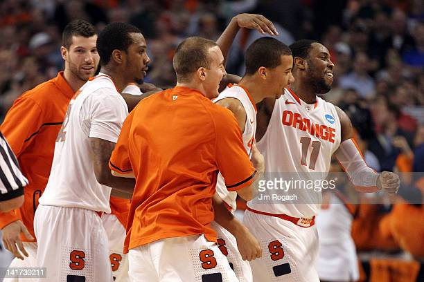 Scoop Jardine and the Syracuse Orange celebrate after defeating the Wisconsin Badgers during their 2012 NCAA Men's Basketball East Regional Semifinal...