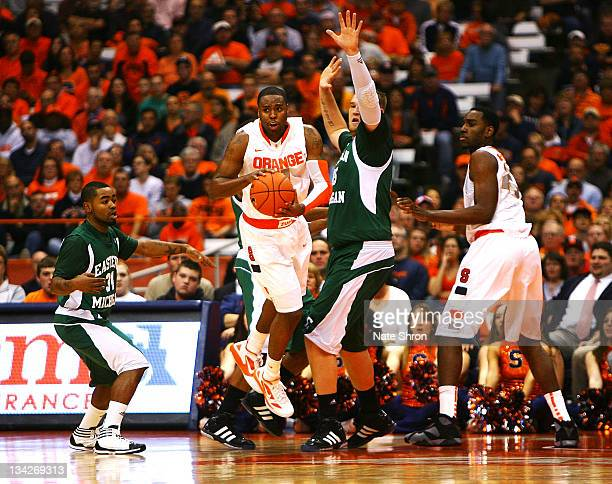 Scoop Jardine of the Syracuse Orange grabs the ball as he prepares to pass against Matt Balkema of the Eastern Michigan Eagles during the game at the...