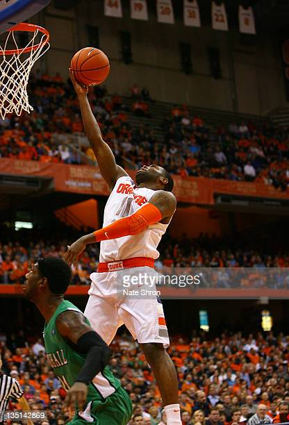 Scoop Jardine of the Syracuse Orange lifts the ball to the basket against Justin Coleman of the Marshall Thundering Herd during the game at the...