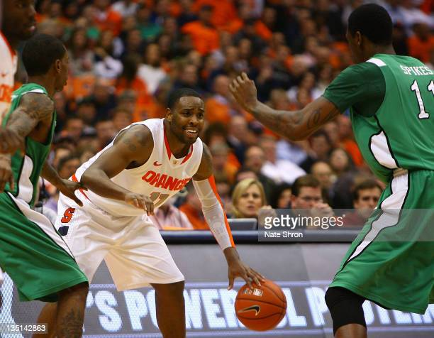Scoop Jardine of the Syracuse Orange looks to pass against Nigel Spikes of the Marshall Thundering Herd during the game at the Carrier Dome on...