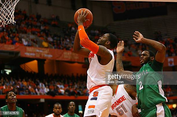 Scoop Jardine of the Syracuse Orange shoots the ball to the basket while being defended by Robert Goff of the Marshall Thundering Herd during the...