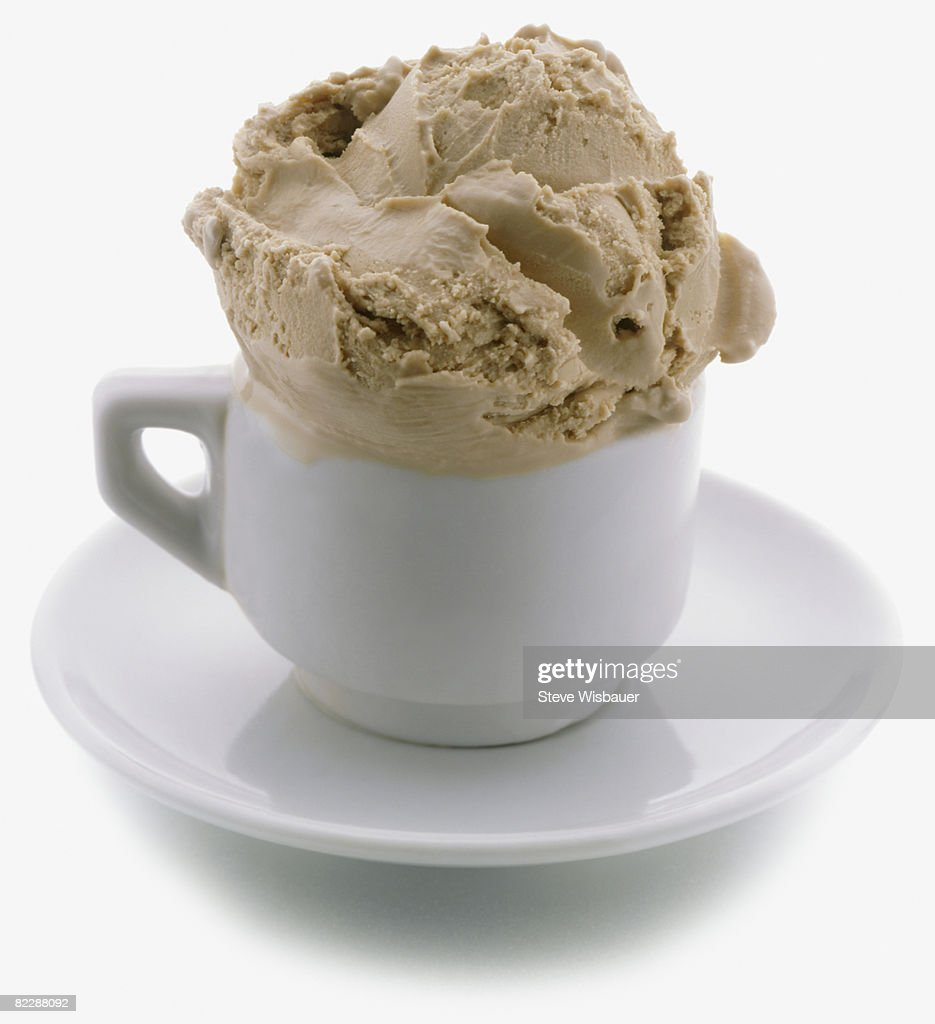 Scoop of coffee ice cream in espresso cup : Stock Photo