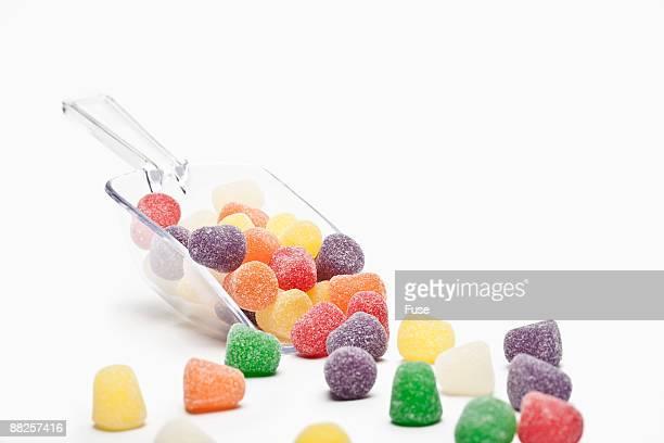 scoop of gumdrops - gum drop stock photos and pictures