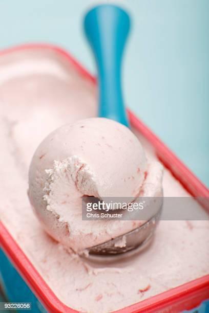Scoop of strawberry ice cream on ice cream scoop, close-up