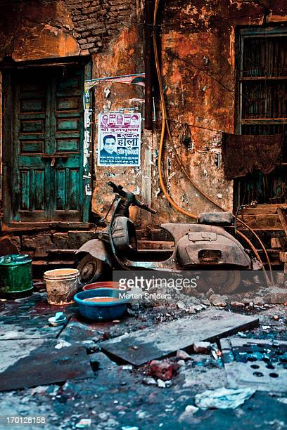 scooter amidst street debris - merten snijders stock pictures, royalty-free photos & images
