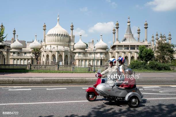 A scooter and side car make their way past The Royal Pavilion during The Mod Weekender on August 27 2017 in Brighton England Brighton became the...