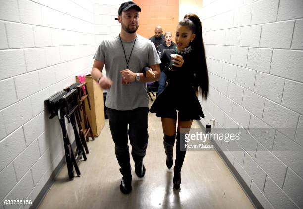 Scooter Braun and Ariana Grande walk backstage during the Dangerous Woman Tour Opener at Talking Stick Resort Arena on February 3 2017 in Phoenix...