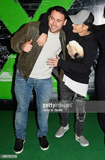 Scooter Braun and Justin Bieber attend the World Premiere of 'Ed Sheeran Jumpers For Goalposts' at Odeon Leicester Square on October 22 2015 in...