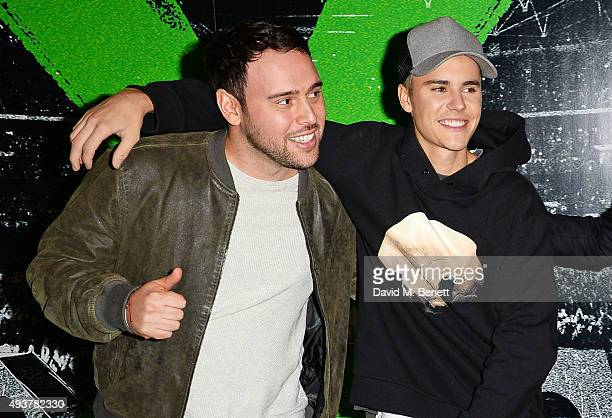Scooter Braun and Justin Bieber attend the World Premiere of Ed Sheeran Jumpers For Goalposts at Odeon Leicester Square on October 22 2015 in London...
