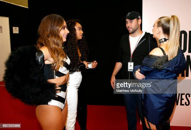 Scooter Braun greets Little Mix during the One Love Manchester concert at Old Trafford Cricket Ground Cricket Club on June 4 2017 in Manchester...
