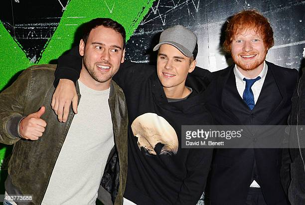 Scooter Braun Justin Bieber and Ed Sheeran attend the World Premiere of Ed Sheeran Jumpers For Goalposts at Odeon Leicester Square on October 22 2015...
