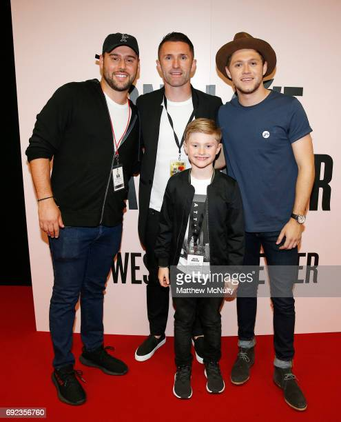 Scooter Braun poses with Robbie Keane son Robert and Niall Horan during the One Love Manchester concert at Old Trafford Cricket Ground Cricket Club...