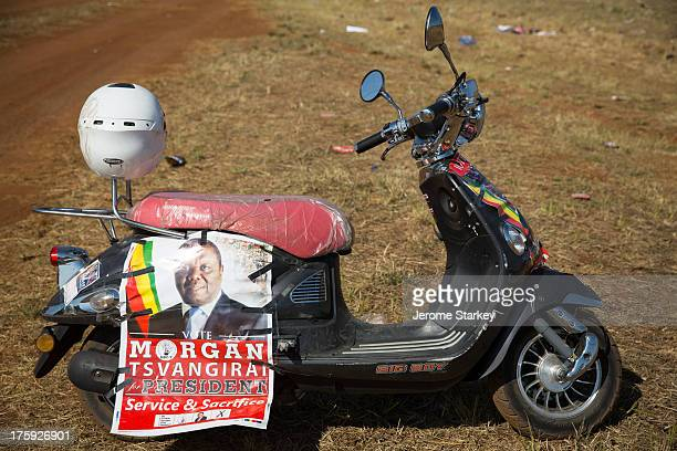Scooter clad in the colours of Zimbabwe's opposition party, the Movement for Democratic Change , in a field in Harare for Morgan Tsvangirai's final...