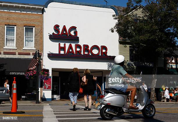 A scooter drives by the Sag Harbor Cinema on Main Street in Sag Harbor New York US on Sunday Aug 31 2008 The business district of the town is listed...