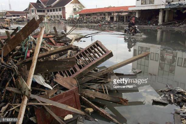 A scooter drives down a flooded street January 10 2005 in Banda Aceh Indonesia The province of Aceh one of the worst hit regions in the December 26...