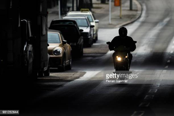A scooter drives on a city street on March 06 2018 in Berlin Germany