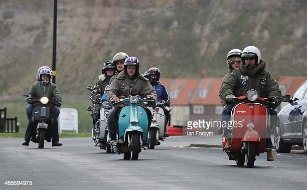Scooter enthusiasts arrive to enjoy the day during a scooter rally on April 19 2014 in Whitby England The popular event brings together hundreds of...