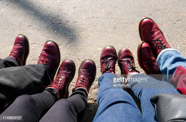Scooter enthusiasts wearing Dr Marten boots sit on the seafront as they join hundreds of others taking part in the first day of the Easter National...