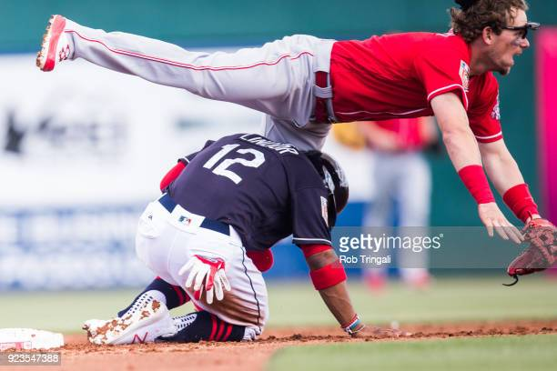 Scooter Gannett of the Cincinnati Reds attempts to complete a double play as Francisco Lindor of the Cleveland Indians slides into him during a...