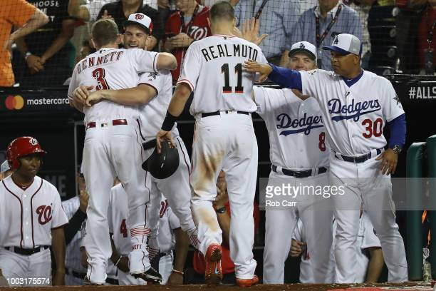 Scooter Gennett of the Cincinnati Reds and National League celebrates with Bryce Harper of the Washington Nationals and the National League after a...