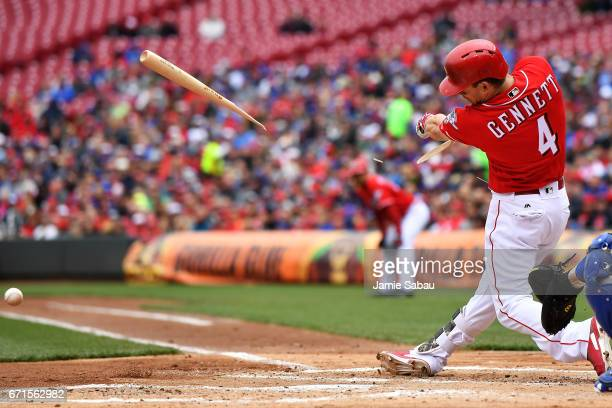Scooter Gennett of the Cincinnati Reds breaks his bat on a hit ball in the first inning against the Chicago Cubs at Great American Ball Park on April...