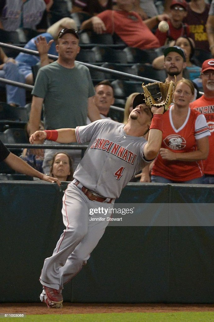 Scooter Gennett #4 of the Cincinnati Reds catches a foul ball for the final out of the MLB game against the Arizona Diamondbacks at Chase Field on July 8, 2017 in Phoenix, Arizona. The Cincinnati Reds won 7-0.