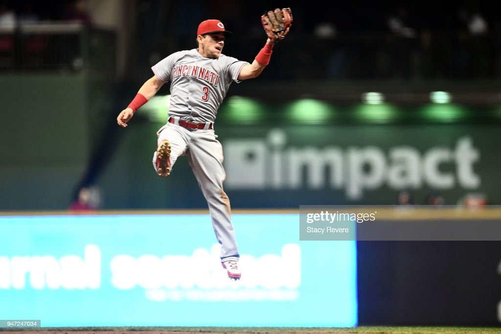 Scooter Gennett #3 of the Cincinnati Reds catches a line drive during the seventh inning against the Milwaukee Brewers at Miller Park on April 16, 2018 in Milwaukee, Wisconsin.