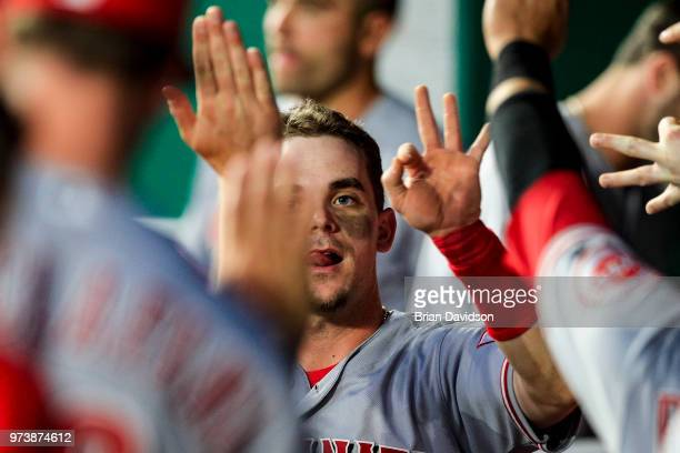 Scooter Gennett of the Cincinnati Reds celebrates scoring a run against the Kansas City Royals during the seventh inning at Kauffman Stadium on June...