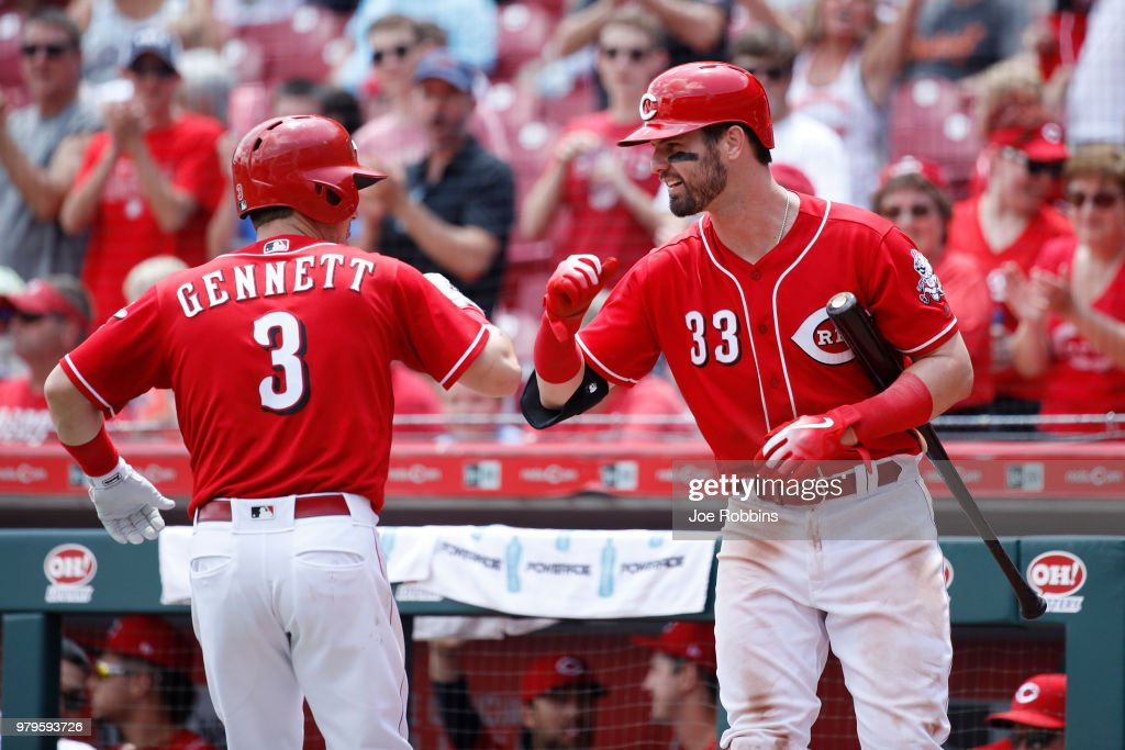 Scooter Gennett #3 of the Cincinnati Reds celebrates with Jesse Winker #33 after hitting a two-run home run to tie the game in the sixth inning against the Detroit Tigers at Great American Ball Park on June 20, 2018 in Cincinnati, Ohio. The Reds won 5-3.