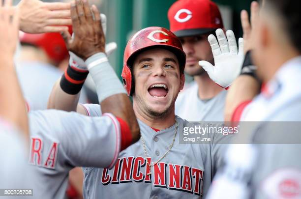 Scooter Gennett of the Cincinnati Reds celebrates with teammates after hitting a home run in the first inning against the Washington Nationals at...
