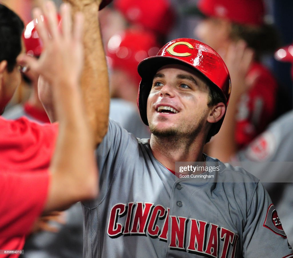 Scooter Gennett #4 of the Cincinnati Reds celebrates with teammates after hitting a ninth inning grand slam against the Atlanta Braves at SunTrust Park on August 19, 2017 in Atlanta, Georgia.