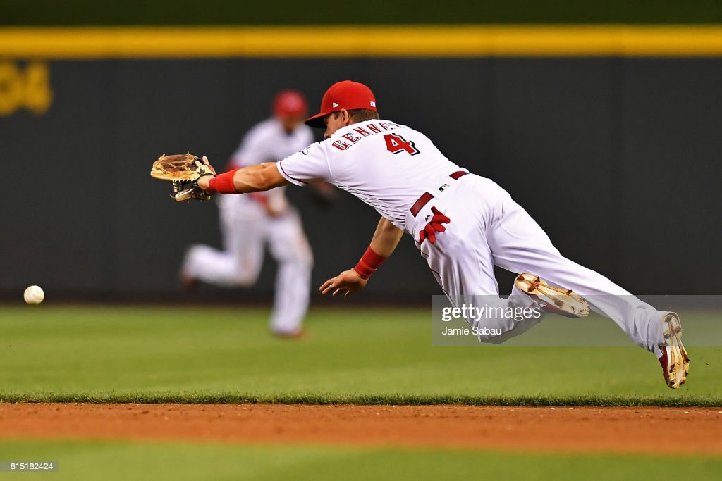 Scooter Gennett #4 of the Cincinnati Reds dives for, but misses a ground ball in the seventh inning against the Washington Nationals at Great American Ball Park on July 15, 2017 in Cincinnati, Ohio. Washington defeated Cincinnati 10-7.